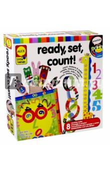 Набор Учимся считать, 8 поделок (1464)Другие виды конструирования из бумаги<br>Замечательный набор, позволяющий ребенку в игровой форме научиться считать, а заодно соорудить несколько поделок (что тоже полезно для внимания и развития мелкой моторики), в которые потом еще можно и играть! <br>Линейка-жираф, фигурки смешных зверушек (куклы на пальцы), цепь с цифрами и т.д. - 8 поделок своими руками!                                                                           <br>В наборе: 170 наклеек и бумажных форм и клей-карандаш.                                                                        <br>Материал: плотная бумага с рисунками.                           <br>Для детей от 4-х лет. Содержит мелкие детали.                                                      <br>Изготовлено: Китай.<br>