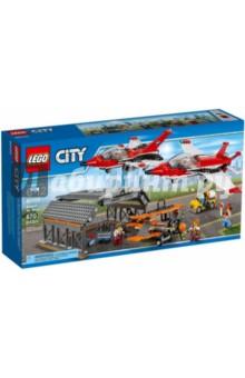 Конструктор City Авиашоу (60103)Конструкторы из пластмассы и мягкого пластика<br>Конструктор Авиашоу от известной компании LEGO - это большой набор, при помощи которого можно создать полноценную авиабазу с ангаром и внушительным самолетным парком. Один раритетный и два современных самолета смогут показать всю силу и мощь своих моторов, удивляя зрителей фигурами высшего пилотажа. Всем присутствующим зрителям останется только запастись биноклями и лицезреть удивительное мастерство пилотов.<br>В набор входят шесть фигурок человечков, представляющих обслуживающий персонал. Именно на их игрушечные плечи возложена серьезная задача - подготовить каждый самолет к взлету и своевременно устранить все недочеты. В их арсенале есть множество средств, которые смогут помочь - погрузчик, выездной трап и так далее.<br>Сборка конструктора LEGO обязательно понравится ребенку и займет все его внимание на долгое время. Параллельно с приятным занятием он будет развивать свою логику и мелкую моторику, одновременно тренируя воображение и учась действовать по инструкции. Собранный парк самолетов и ангар смогут занять достойное место в игровой коллекции.<br>В наборе: 6 фигурок, детали конструктора.<br>Материал: пластмасса.<br>Упаковка: картонная коробка.<br>Для детей 6-12 лет.<br>Сделано в Китае.<br>