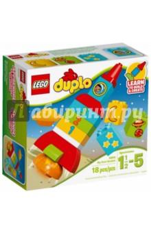 Конструктор LEGO DUPLO Моя первая ракета (10815)Конструкторы из пластмассы и мягкого пластика<br>Учитесь создавать и строить из больших кубиков LEGO DUPLO на примере красочной ракеты и планеты - в набор входят три строительные карты, которые можно использовать в качестве примера. Поощряйте ролевые игры и помогите ребёнку развить базовые навыки счета, сопоставляя кубики, украшенные луной, 2 планетами и 3 звездами с соответствующими кубиками с цифрами.<br>Кубики LEGO DUPLO интересны и безопасны для маленьких ручек<br>Материал: пластик.<br>Детям от 1 года и 6 месяцев до 5 лет <br>Сделано в Дании.<br>