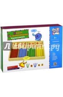 Набор Учимся считать (дерево) (66443)Веера, счетные палочки<br>Набор счетного материала Учился считать - обучающее и развивающее пособие для маленьких школьников и дошколят. В набор входят разноцветные счетные палочки, окрашенные в основные цвета: красный, желтый, синий, зеленый, и деревянные пластинки с изображением цифр и арифметических знаков. С помощью этого набора можно сформировать у ребенка понятия цифр, чисел и научить основным математическим действиям.<br>В наборе: цифры и знаки, счетные палочки четырех цветов.<br>Изготовлено из дерева.<br>Рекомендуется для детей старше 3-х лет. Содержит мелкие детали.<br>Сделано в Китае.<br>