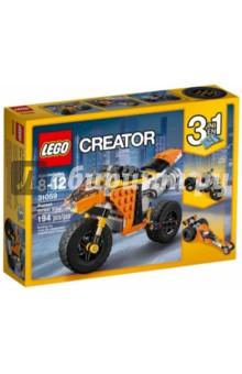 Конструктор Creator. Мотоцикл оранжевый (31059)Конструкторы из пластмассы и мягкого пластика<br>Прокатись на удивительном Оранжевом уличном мотоцикле 3 в 1, выполненном в апельсиновой гамме с деталями чёрного и белого цвета, с реалистичным двигателем, экстра-широкими резиновыми шинами с высоко установленными брызговиками, действующей пружинной подвеской и узнаваемым спортивным дизайном. Посмотри, как точно выполнена выхлопная труба, лобовое стекло и руль. Скорее запрыгивай на него и в путь! Трансформируется в Шоссейный велосипед или Драгстер!<br>Для детей 8-12 лет.<br>Изготовлено из пластика.<br>