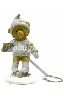 Украшение елочное Медвежонок на коньках (41966)Новогодние сувениры<br>Украшение новогоднее подвесное.<br>Размер: 6х4х8,5 см.<br>Материал: полирезина<br>Сделано в Китае.<br>